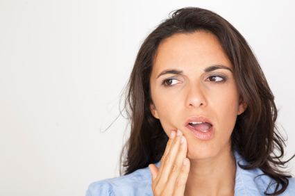 Woman in need of gum disease treatment in Scappoose, OR.